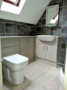 Orchid Bathrooms - Bevel Line Limestone