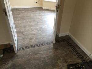 Featherby Flooring - Camaro Ocean Slate (2319) with Bespoke Roman Key Border (2684)