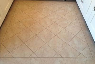 Camaro Classic Yorkstone 2336 and Classic Oak 2058 marquetry strip with half tile border and centre on 45º angle (Emperor Flooring NE)