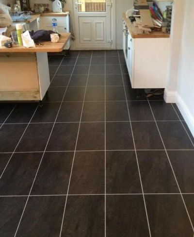 Colonia Welsh Raven Slate 4535 and Silver 0025 feature strip (S and M Flooring)