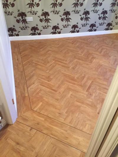 Colonia Golden Koa 4403 in a herringbone pattern (Bedlington Flooring)