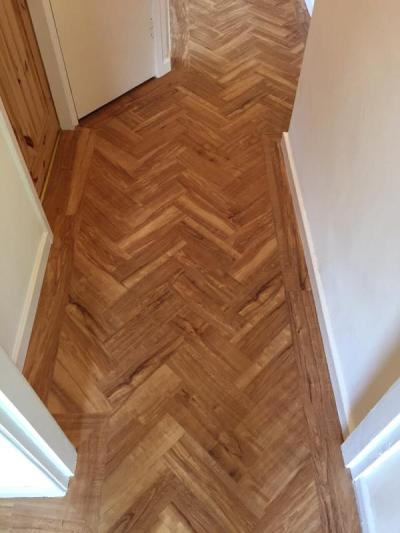 Flooring UK, Camaro Nut Tree in herringbone pattern with a single plank perimeter