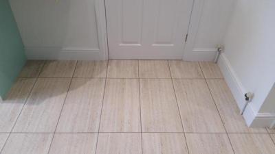 Trimmer Flooring, Camaro Travertine with Coffee grouting strip