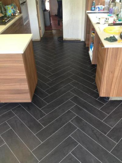 S&M Flooring, Camaro Atlantic Slate with Ice grouting strip in herringbone pattern