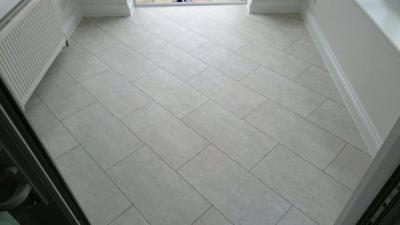 Absolute Flooring, Camaro White Metalstone with Graphite grouting strip