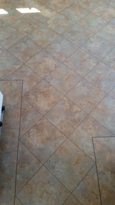 DW Design Floor, Camaro Romano Stone with Brown feature strip and Coffee grouting strip
