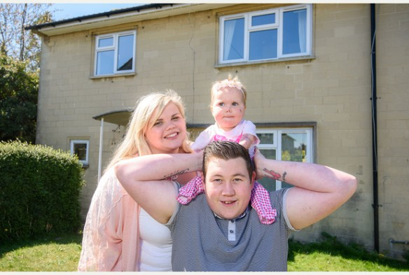 Harmonie Rose-Allen with her parents Ross Allen and Freya Hall in front of their new house, Oak Hill Road, Foxhill, Bath.