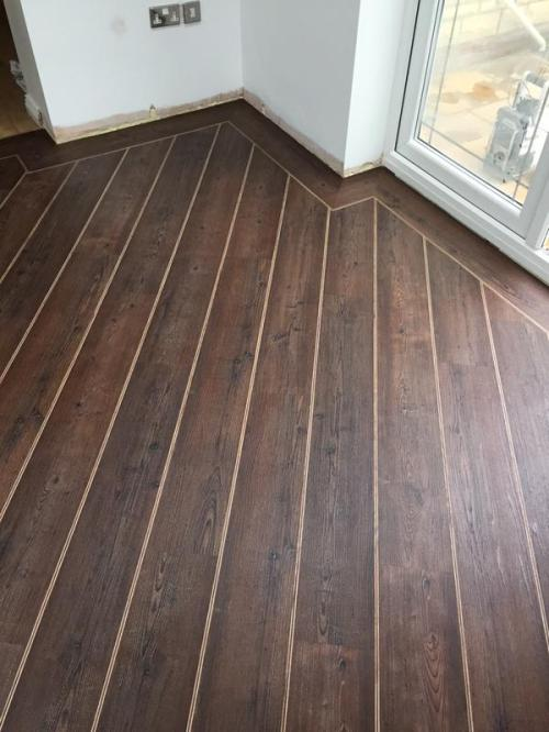 April - Emperor Flooring NE, Colonia Kings Oak with Walnut and Natural Oak Marquetry Strips