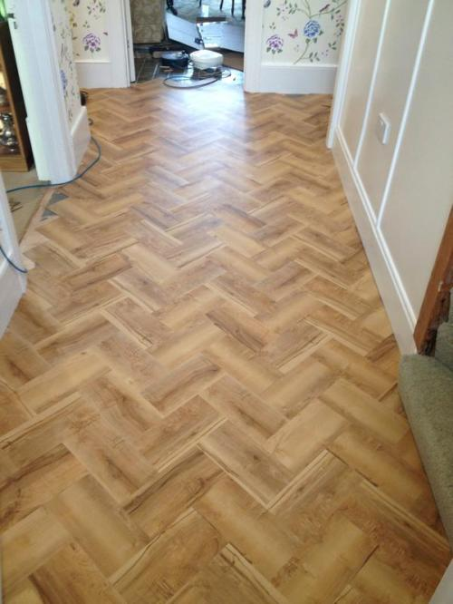 July - S&M Flooring, Colonia Oxford Maple in herringbone pattern