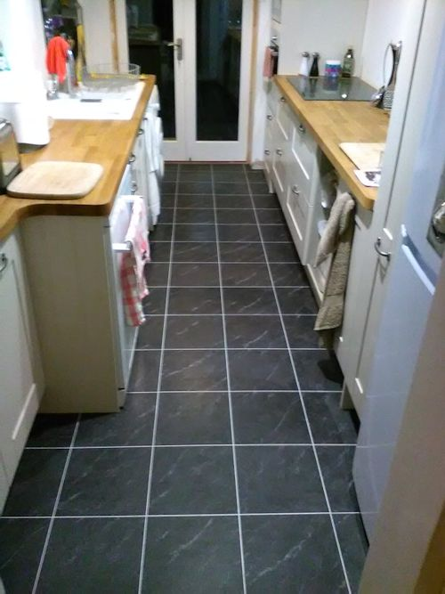 Perfecto Flooring, Camaro Black Marble with Ice grouting strip