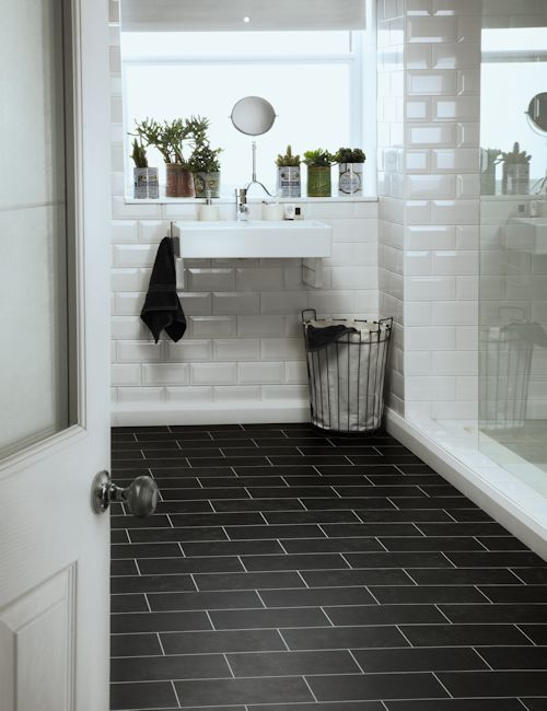 Colonia Imperial Black Marble half cut tiles in a brickwork design with Ice grouting strip