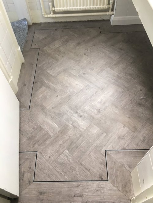 Balflooring, Camaro Smoke Brushed Elm in herringbone pattern with perimeter border and Black Feature Strip