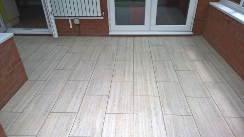 Paul Hood & Sons, Camaro Travertine in brickwork pattern with Coffee Grouting Strip